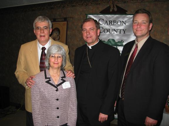 BILL O'GUREK/TIMES NEWS Bishop John Barres, center, of the Diocese of Allentown joins Dr. Clement and Sophie McGinley of Jim Thorpe in kicking off the 2011 Allentown Diocese Bishops Annual Appeal in Carbon County. The McGinleys are the honorary co…