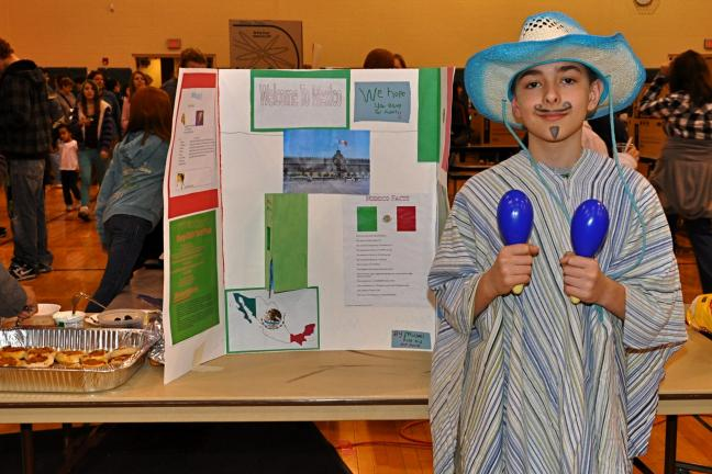 VICTOR IZZO/SPECIAL TO THE TIMES NEWS Representing our neighbors to the South, Nick Panick, Maracas in hand, provided information about Mexico to visitors at Multicultural Night at Penn Kidder Elementary School.