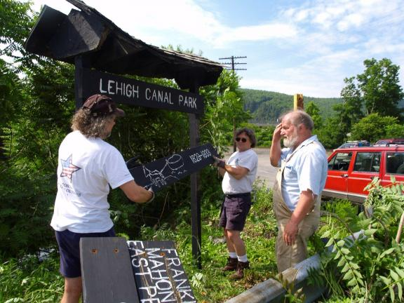 AL ZAGOFSKY/SPECIAL TO THE TIMES NEWS In this file photo members of the D&L Trail Tenders erect a sign as they ready for the opening of the Lehigh Canal Park in Weissport in 2007.