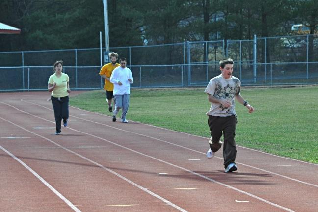 VICTOR IZZO/SPECIAL TO THE TIMES NEWS Carbon County Special Olympians warming up on the JTAHS track are, left to right : Delina Rodrigues, Chris Schweibenz, Nick Boone, and Dan Kurtz.
