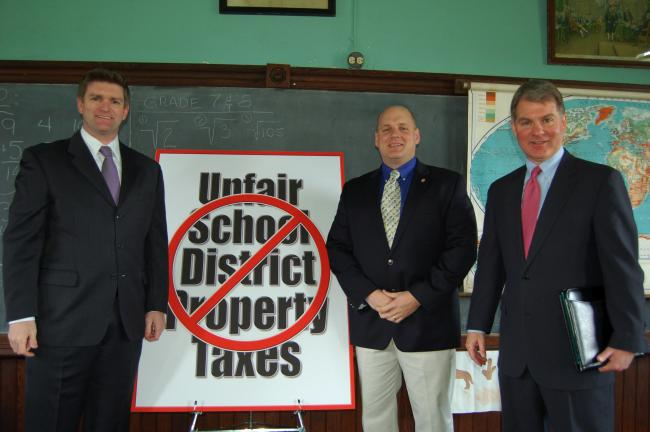 Gail Maholick/TIMES NEWS State Sen. John Yudichak (D-14), state Rep. Doyle Heffley (R-122) and state Sen. Dave Argall (R-29) introduced bipartisan legislation to help Pennsylvania voters eliminate the state's outdated and archaic school property tax…