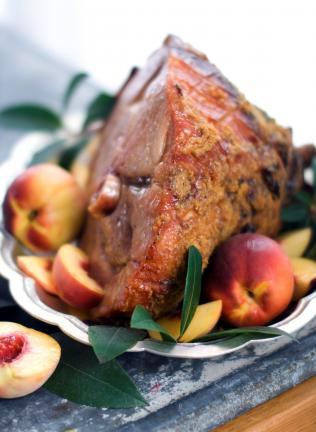This March 15, 2011 photo shows an apricot-peach and gingersnap crusted baked ham in Concord, N.H. Here, the bright flavors of apricot-peach jam spiked with some Dijon mustard and brown sugar provide the glue, if you will, for a spicy crust of…