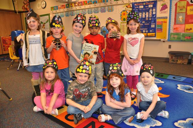 AMY MILLER/TIMES NEWS Some of the Pre-K Counts students paused from their pirate adventures on Friday to pose for a photo. They are, seated from left, Brinn Harwood, Cameron Keeler, Madeline Millard and Nekya Strohl. Standing, Anastasia Susko, Jack…