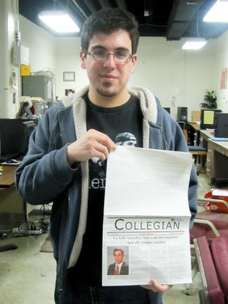"Special to the TIMES NEWS LaSalle Collegian editor-in-chief Vinny Vella holds a copy of the April 14 edition, the top front blank except for four words - ""See below the fold"" - in small print."