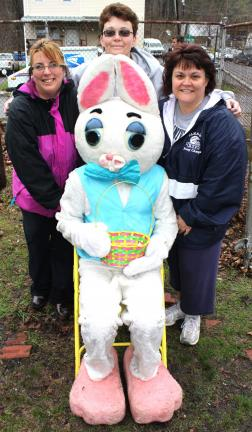ANDREW LEIBENGUTH/SPECIAL TO THE TIMES NEWS North and Middle Ward Playground officers, from left, president Kim Snyder, Jody Kellner and Deedee Bonetsky pause for a quick photo with the Easter Bunny.