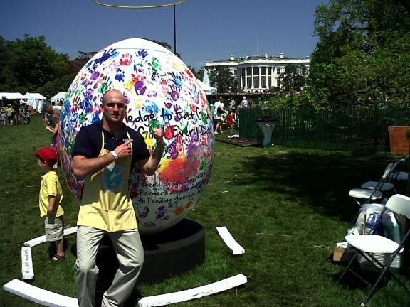 SPECIAL TO THE TIMES NEWS Ben Kunkel, a Jim Thorpe Area High School graduate and current Penn State University student, stands in front of the 8-foot tall Easter Egg that he helped with during the 133rd annual White House Egg Roll, held on the South…