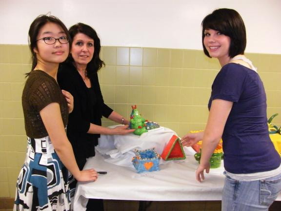 CAROL ZICKLER/SPECIAL TO THE TIMES NEWS Looking over some of the creative ceramic pieces at Panther Valley High School during Literacy Night are Judy Lin, Mrs. Kim Gallagher, art teacher; and Theressa Eckhart.