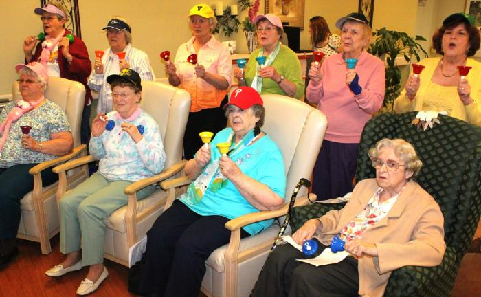 ANDREW LEIBENGUTH/SPECIAL TO THE TIMES NEWS Members of the Tamaqua Salvation Army Older and Bolder newly formed bell choir performed recently for residents at the St. Luke's Hospital in Coaldale and Maple Shade Meadows in Nesquehoning. Salvation…