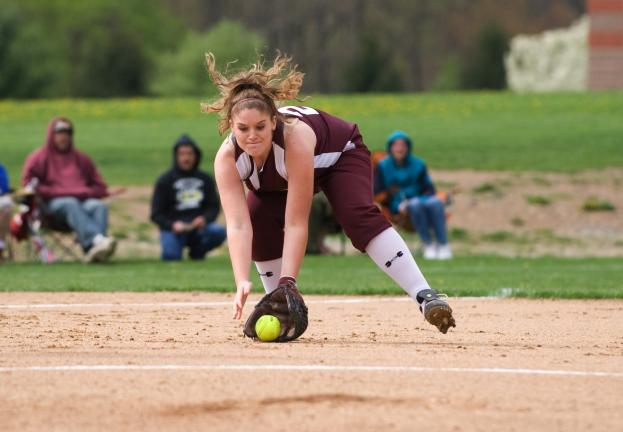 bob ford/times news Lehighton's Ashley Sensinger scoops up the ball at third base during Friday's game against Stroudsburg.