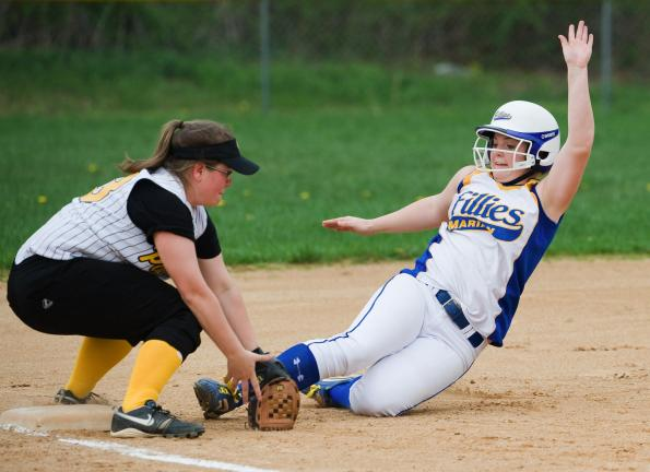BOB FORD/TIMES NEWS Marian's Kayla Knight slides into third base safely as Panther Valley's Krista Knepper covers.