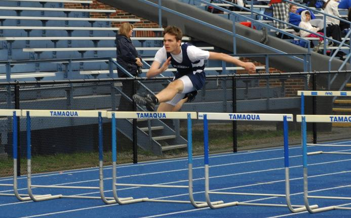 ron gower/times news Eric Herzog of Tamaqua won the 100 high hurdles against Minersville in a time of 15.6