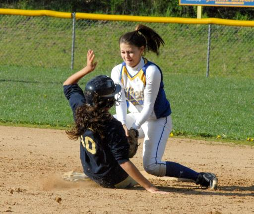 ron gower/times news Marian second baseman Gabby Green puts the tag on Schuylkill Haven's Alicia Miller for the final out of the game in the top of the seventh, preserving the Fillies' 3-2 victory.