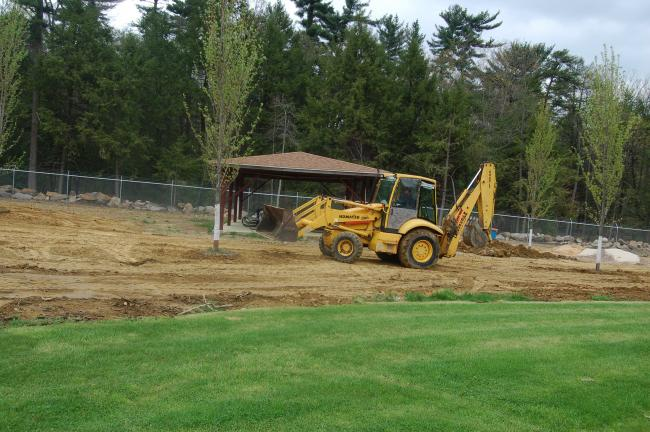 TERRY AHNER/TIMES NEWS Work is done to enlarge the grass area around the inside of the Palmerton Memorial Pool.