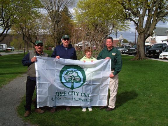 DAVID WARGO/SPECIAL TO THE TIMES NEWS Summit Hill Shade Tree Commission members accept a flag as part of the honor of being designated as a Tree City USA community by the Arbor Day Foundation. Pictured left to right are: John Kupec, Dr. Louis…