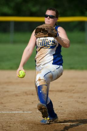 bob ford/times news Marian's Kayla Knight unwinds with a pitch against Nativity.