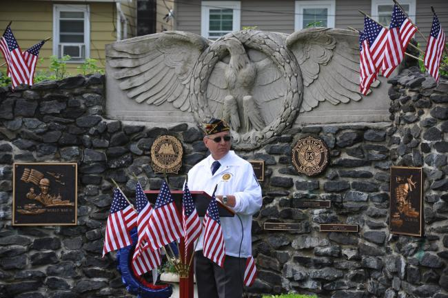 Ron Gower/TIMES NEWS Richard D. Pogwist, past commander of the Lansford American Legion Post, conducts Memorial Day service in front of veterans' monument at Kennedy Park in Lansford.