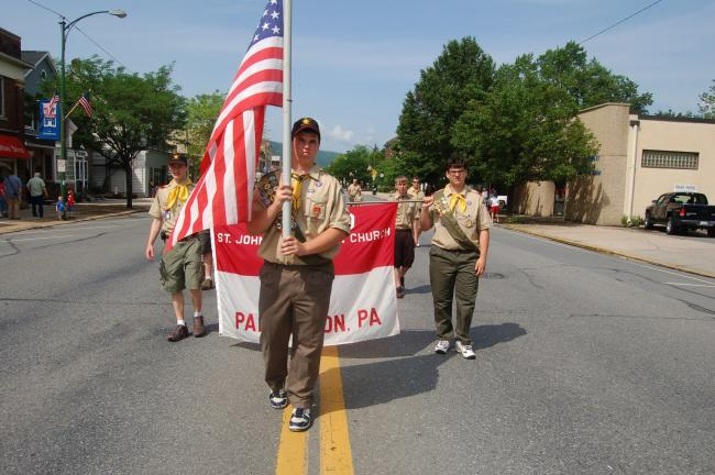 TERRY AHNER/TIMES NEWS  This local boy scout group displays their patriotism as part of the Memorial Day Parade in Palmerton on Monday.