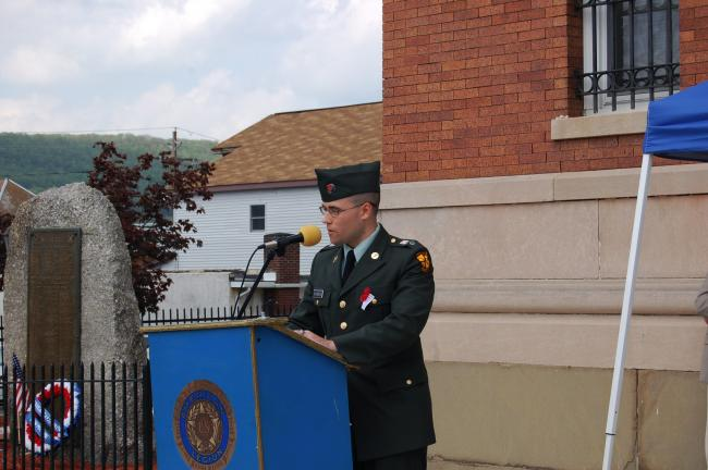 CHRIS PARKER/TIMES NEWS Shippensburg University student Aric Shubeck of Summit Hill speaks at Coaldale's Memorial Day services, held Sunday in the Seek section of the borough, and at the Veterans Memorial Garden on Third Street.
