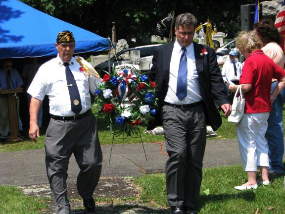 LIZ PINKEY/SPECIAL TO THE TIMES NEWS Grand Marshal Lawrence J. Kabana, left, and Tamaqua Mayor Christian Morrison lay a memorial wreath at the Soldiers' Circle monument at Odd Fellows Cemetery.