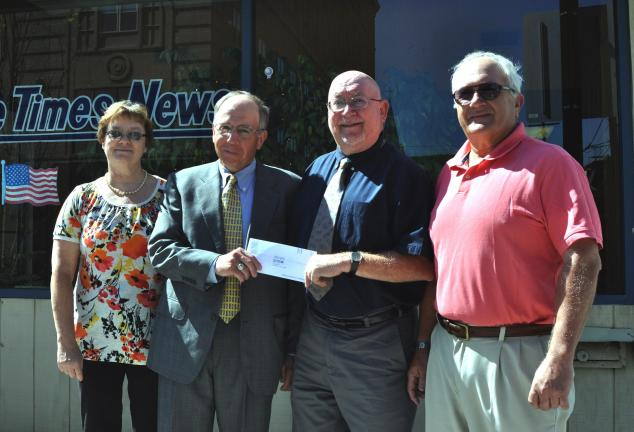 DONALD R. SERFASS/TIMES NEWS  A donation by Pencor, Inc., to the Tamaqua Blue Raider Foundation establishes a scholarship fund to be used to recognize a Tamaqua Area High School scholar-athlete. The award will bear the name of the late Joseph M…