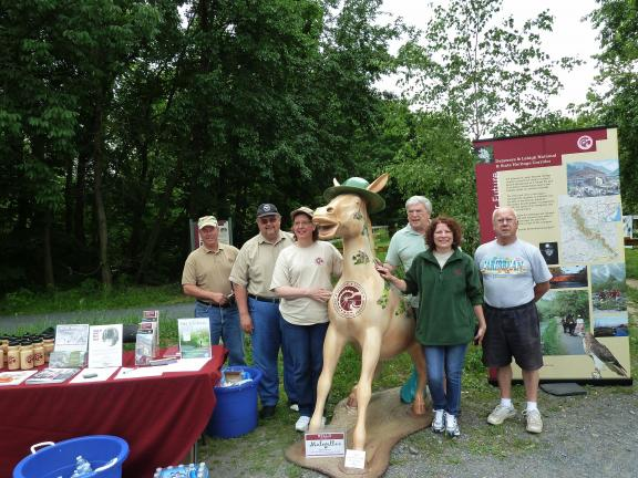 "SUSAN LAYLAND/SPECIAL TO THE TIMES NEWS Delaware & Lehigh (D&L) National Heritage Corridor members pose with ""Mulegellan,"" the organization's mascot. From left, Dennis Scholl, Dale Freudenberger, Loretta Susen, Gary Fedorcha, Rayne Schnabel and…"