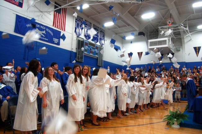 TERRY AHNER/TIMES NEWS  It's off with the caps as members of Palmerton Area High School's Class of 2011 celebrate following commencement exercises Wednesday inside the high school gymnasium.