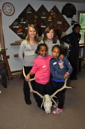 AMY MILLER/TIMES NEWS Pen pals from Panther Valley and Prince Hall elementary schools enjoy playing with various wildlife shells and bones during their recent visit to the Carbon County Environmental Education Center in Summit Hill. They are, front,…