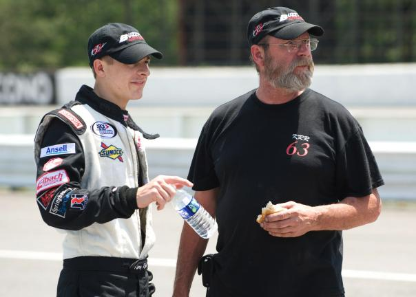 bob ford/times news Driver Kory Rabenold (left) and his crew chief and father Buzzy Rabenold check out action on the track during ARCA qualifying on Friday.