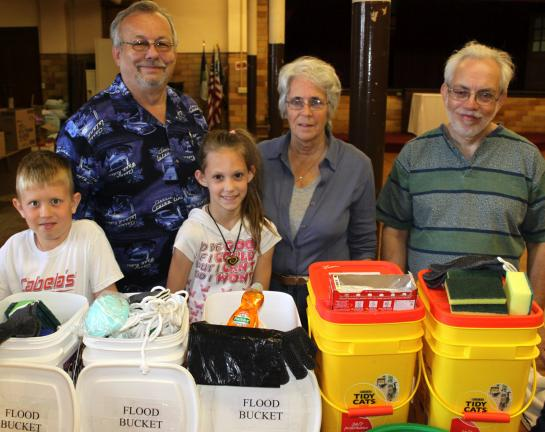Andy Leibenguth/times news Tamaqua Evangelical Lutheran Church volunteers Alexander Barron, 8, Tim Stahl, Elizabeth Stahl, 10, and outreach chairperson Fran Stahl and Bob Jones.