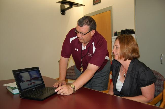 Gail Maholick/TIMES NEWS Tim Tkach, principal at Lehighton Area High School and Jamie Drake, treatment program manager, for Carbon-Monroe-Pike Drug and Alcohol program, preview a video about drug and alcohol abuse that was created by students at…