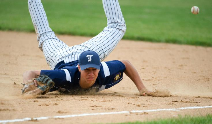 BOB FORD/TIMES NEWS Tamaqua's Jordan Heisler makes a diving attempt to catch a sharp liner hit down the first base line, but comes up short.