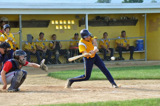 RON GOWER/TIMES NEWS Jake Kern of Northern Valley Legion swings at the ball and hits a single in game against Lower Macungie on Sunday. Later in the game, in the eighth inning, Kern scored on a wild pitch to give his team a 3-2 win.