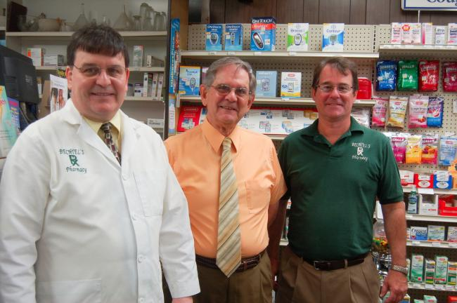 TERRY AHNER/TIMES NEWS Edward Bechtel (left), Joe Bechtel (center) and Jack Bechtel (right) celebrate the 50-year anniversary of Bechtel's Pharmacy in Slatington.
