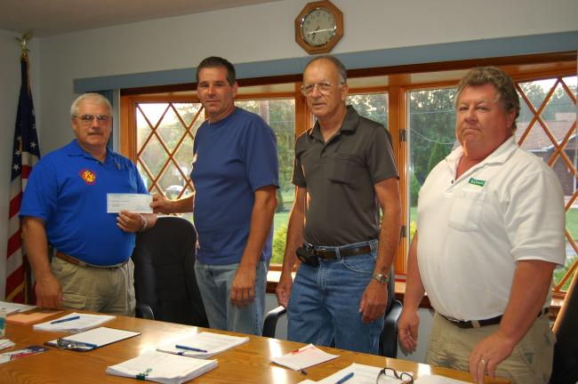 Gail Maholick/TIMES NEWS Franklin Township supervisors presented a check of $30,000 to Bruce Wolfe, fire chief, Franklin Township Volunteer Fire Company. From left are, Wolfe, and Rod Green, chairman; Larry Smith, and Paul Kocher, vice chairman.