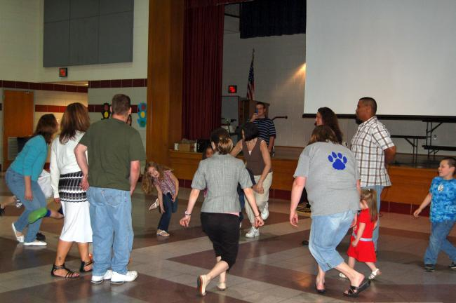 LINDA KOEHLER/TIMES NEWS Several parents with their children participated in learning a new dance at Pleasant Valley Elementary's Family Music Night.