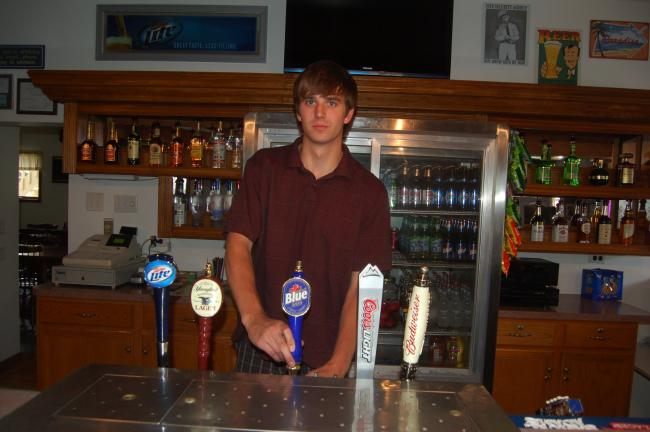 TERRY AHNER/TIMES NEWS Derrick Drey, manager, stands behind the bar at the West End Saloon, which recently re-opened.