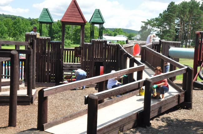 Ron Gower/TIMES NEWS The playground at Phifer's Ice Dam in Franklin Township is repainted by the Franklin Lions Club. The equipment had been all brown, but some green and red colors have been added.