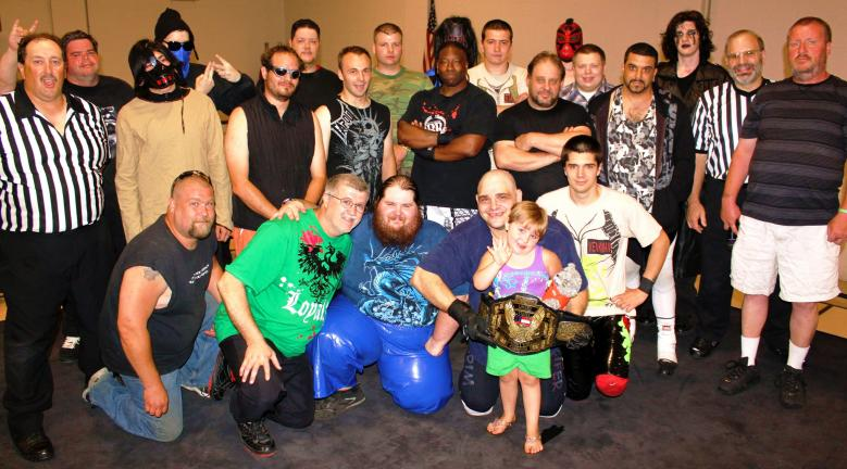 ANDY LEIBENGUTH/TIMES NEWS Pictured being recognized for her bravery during the wrestling show's intermission is Rayne Shellhamer, 4, surrounded by Elite Generation Wrestling staff, volunteers and about a dozen of their professional wrestlers.