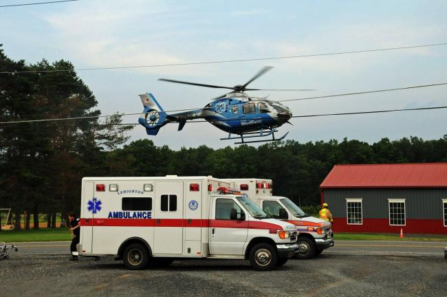 Larry Neff/special to the times news The MedEvac helicopter takes off from the scene of Sunday evening's incident.