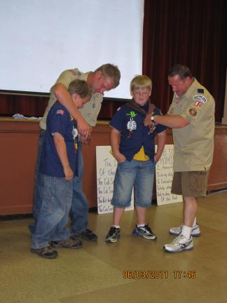 SPECIAL TO THE TIMES NEWS Shane Kratzer and son Noah, left, and Joe Schatz with his son Ben, right. The boys are two of the five Cub Scouts who advanced to Webelos.