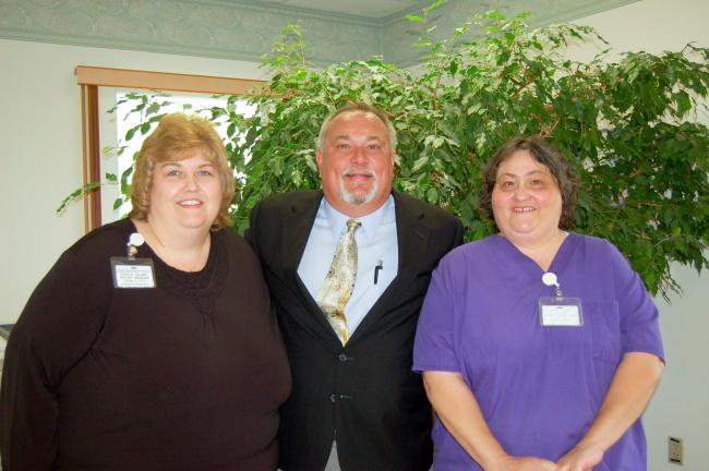 The top two honorees were Crystal Helmer, who served 30 years, and Nancy Muthard, 35 years. They are pictured here (left to right) with president and CEO Michael A. Mickey.