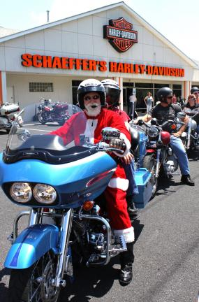 ANDY LEIBENGUTH/TIMES NEWS Santa Claus with 20 biker elves prepare to depart on their Schaeffer's Harley-Davidson's Christmas in July Toy Run.