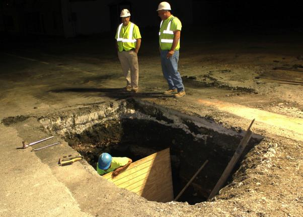 Pictured around 3 a.m. this morning are Rob Jones, Tamaqua Public Works Director, left, and Mark Emerich, General Superintendent with Ankiewicz Enterprise of Tamaqua, looking over one of the tow holes that will house a cemented anchor block for new…