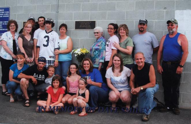 SPECIAL TO THE TIMES NEWS The late Dave Smiley's family and friends gathered at the Towamensing baseball field to honor his memory and in recognition of his love for baseball.
