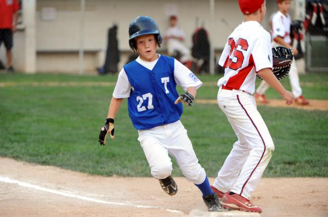 NANCY SCHOLZ/Special to THE TIMES NEWS Tamaqua's Nate Boyle scampers to first base safely in Wednesday's Section 6 9-10 Little League tournament game against Warwick.