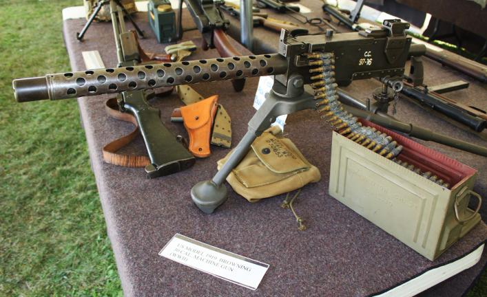 ANDREW LEIBENGUTH/TIMES NEWS Pictured under the Endless Mountains War Museum tent during the Armed Forces Tribute is a U.S. Model 11 Browning 30 caliber machine gun (WWII).