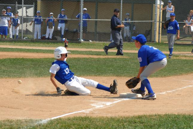 ron gower/times news Tamaqua's Josh Inama is safe at third base while Franklin Township third baseman Collin Haupt waits for ball.