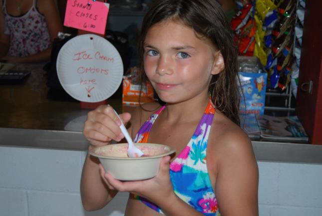 RON GOWER/TIMES NEWS Ten-year-old Aaliyah Stanley of Lehighton enjoys her sugar-free yogurt with oatmeal at the Lehighton Municipal Swimming Pool. The pool has added healthy food to its refreshment stand options.