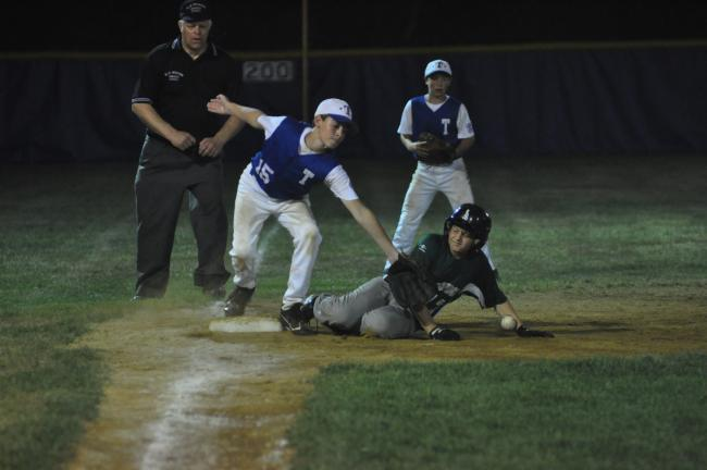 MIKE FEIFEL/TIMES NEWS Tamaqua's Josh Inama tries to field a throw from his catcher as Pennridge's Andrew Walters slides in safely at third during last night's Section 6 10-11 contest at Franklin Township. Tamaqua stayed alive with a 12-10 win.