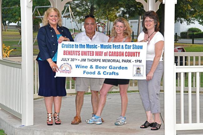 "VICTOR IZZO/SPECIAL TO THE TIMES NEWS Displaying the ""Cruise to the Music"" banner in the Gazebo at Memorial Park in Jim Thorpe for this Saturday's upcoming United Way event are, left to right, Angela Nardini, vice president of PR Media & Marketing;…"